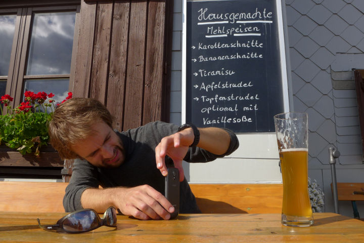 Me photographing a beer on a hiking trip in Totes Gebirge.
